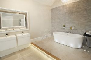 Ground floor: En-suite bathroom with underfloor heating, double sinks and large freestanding bath