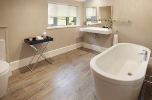 Ground floor: En-suite bathroom with underfloor heating, double sink and bath for two