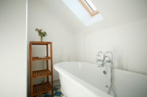 Second Floor: Family bathroom with roll top bath and wc