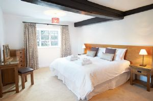 First floor: Double bedroom with 6' bed which can convert to single beds upon request