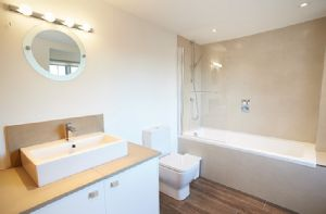 First floor: En suite bathroom to double bedroom with 6' zip and link bed