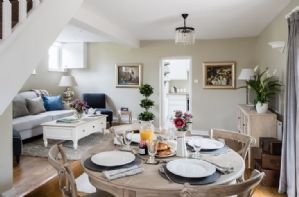 Ground floor: The open plan ground floor layout is split over two levels including a dining area and cosy sitting room