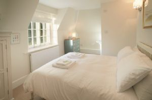 First floor:  Double bedroom with a 5' bed and en-suite shower room