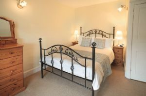 First floor: Double bedroom with 4'6 bed and en-suite bathroom
