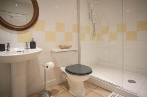 First floor: En-suite shower room with walk in shower
