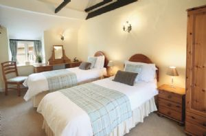First floor: Twin bedroom with 3' single beds and en-suite shower room