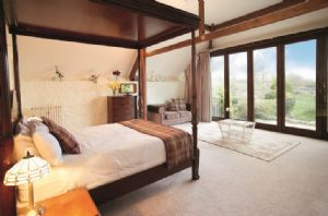 First floor: Master bedroom with 5' Kingsize four poster bed and en-suite bathroom