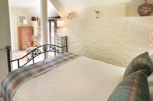 First floor: Double bedroom with 4'6 bed and en-suite bathroom