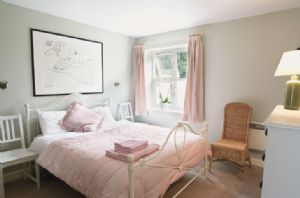 Ground floor:  Master bedroom with 5' bed and en-suite bathroom with shower over bath