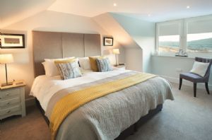 First floor: Double bedroom with 6' super King-size bed and walk in cupboards