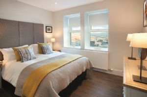 Ground floor: Master bedroom with 5' King-size bed, smart television and en-suite shower room