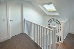A light and airy staircase leads to the first floor bedrooms