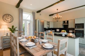 Ground floor: Kitchen/breakfast room with dual aspect windows and doors to front courtyard and back terrace