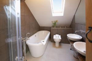First floor: Bathroom with bath, shower, twin basins and wc