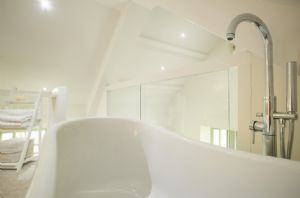 Freestanding roll top bath in the master bedroom