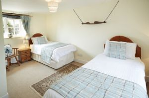 Ground floor: Twin bedroom with 3' single beds