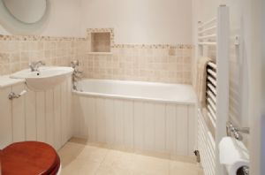 First floor: En-suite bathroom with bath and hand held shower attachment
