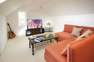 "Second floor: Family room with 55"" television and Blu-ray"
