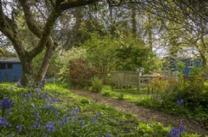 Myrtle Cottage has an extensive, fully enclosed garden with outdoor seating and shepherd's hut