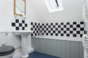 First floor: En-suite bathroom with bath and hand held shower