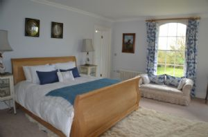 First floor: The Blue bedroom with 6' Superking sleigh bed and en-suite bathroom.