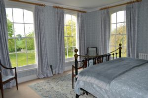 First floor: The master bedroom has double aspect windows with garden views
