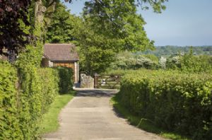 The property is at the end of a private drive and is surrounded by stunning views of the Somerset countryside