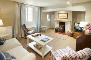 Ground floor: Large sitting room with wood burning stove. Furnished with vintage pieces from Castle Howard itself and carefully chosen modern furnishings, the cottage is perfectly appointed