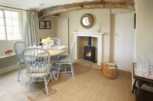 Ground floor: Dining room with exposed wooden beams and wood burning stove