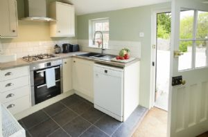 Ground floor: Refurbished contemporary kitchen looking onto the lovely garden and out door eating area