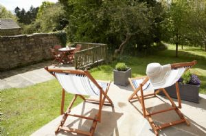 Relax in the deck chairs, over looking the sun drenched, spacious garden