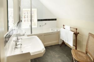 First Floor: Contemporary bathroom with bath and over bath shower