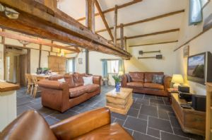 Exposed beams are a feature throughout the property