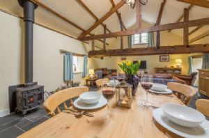 Ground floor: Open plan dining area with wood burning stove
