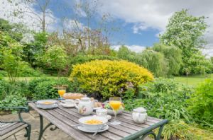 Alfresco dining in the private garden
