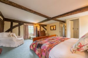 First floor: Large double bedroom (6'5 bed) with en-suite