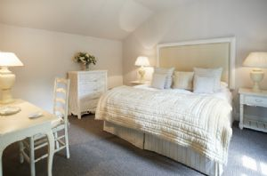 Ground floor: Double bedroom with zip and link beds and en-suite shower room