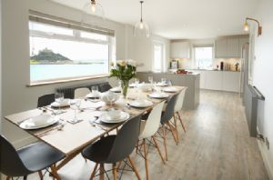 Renovated to a high standard with Scandinavian style furniture high end lighting and wooden floors with a spacious and light dining room for entertaining whilst looking out over the view of St Michael's Mount