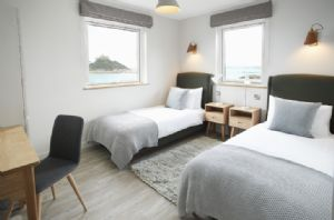 Twin bedroom with 180 degree sea views the bedroom interior design is stylish and fresh with light oak furniture and an accent of warm coastal tones