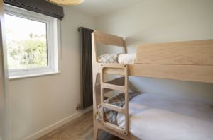 Scandinavian bunk beds and new wooden floors throughout