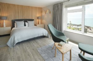 The master bedroom is beautifully renovated with a 6' bed reading area with a unique 180 degree sea views of St Michael's Mount