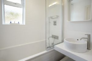 Renovated to a high standard contemporary design bathroom with shower above
