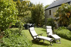 Relax in the outdoor furniture within the private garden