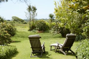 Enjoy the relaxing country views in the deck chairs from the lovely garden