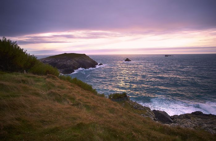 The lighthouse is located on a headland between the sandy beaches of Harlyn and Constantine Bays, four miles west of Padstow