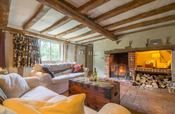Ground floor:  Sitting room with exposed beams and open fire