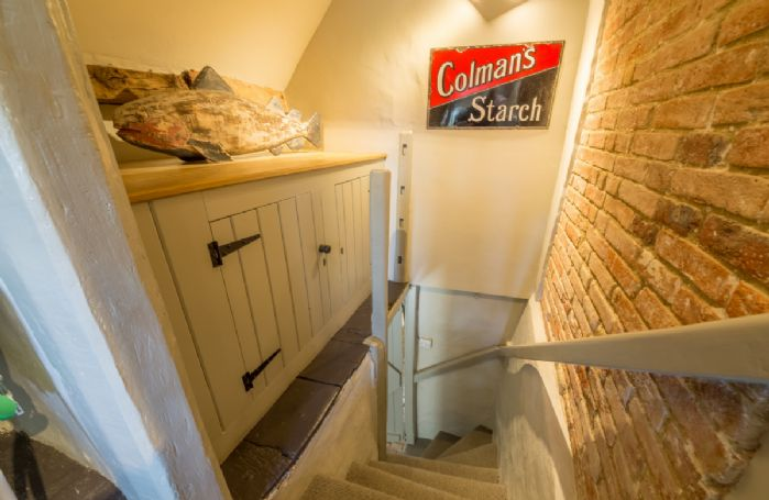 Both bedrooms are accessed by their own staircases