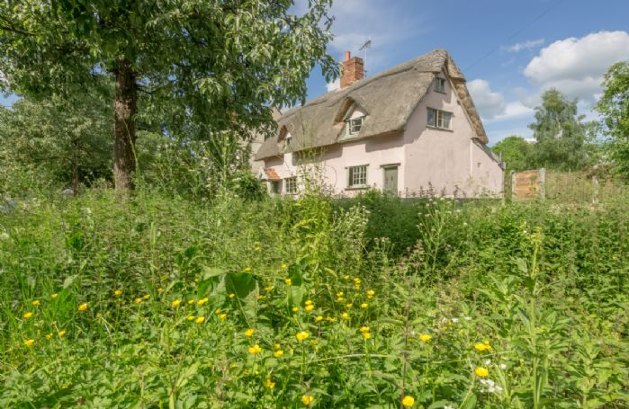 Gardener's Cottage is a Grade II listed 17th century thatched timber frame cottage