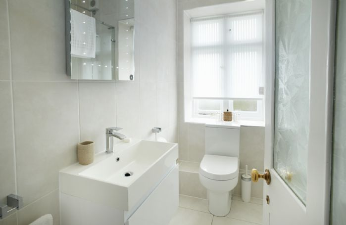 Ground floor: Bathroom with shower over bath
