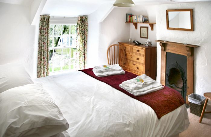 Narrow stairs to double bedroom with 5' bed